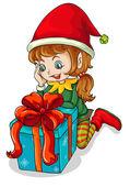 An elf beside a gift — Stock Vector