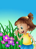A girl watching the violet flowers in the garden — Stock Vector