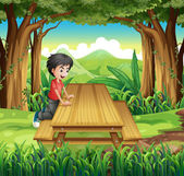 A boy in the forest with a wooden table and bench — Stock Vector