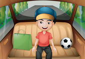 A boy sitting inside a running car — Stock Vector