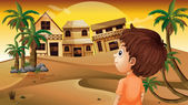 A boy at the desert standing in front of the wooden houses — Stock Vector