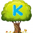A tree with a letter K — Stock Vector