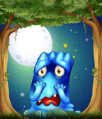 A forest with a sad blue monster — Stock Vector
