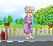 An old woman at the street with a cane standing near the mailbox — Stock Vector