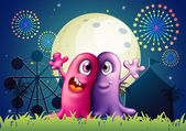 A carnival with two one-eyed monsters — Stock Vector
