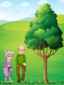 Two grandparents at the hill near the tree — Stock Vector