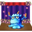 A stage with a blue monster balancing the three lighted candles — Векторная иллюстрация