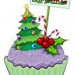 A cupcake with a christmas tree and a card — Stock Vector #32642181