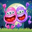 Two happy monsters at the amusement park — Stock Vector
