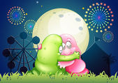 A pink and a green monster hugging each other in front of the am — Stock Vector