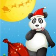 A panda wearing Santa's hat while eating a cane lollipop — Stock Vector