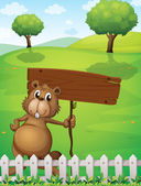 A beaver holding an empty signboard standing near the fence — Stock Vector