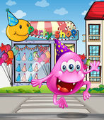 A happy beanie monster jumping in front of the party shop — Stockvector