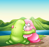 A green and a pink monster hugging each other at the riverbank — Stock Vector