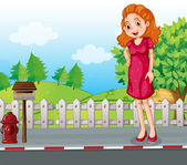 A woman at the roadside near the wooden mailbox — Stock Vector