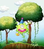 A monster playing near the tree in the forest — Stock Vector