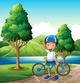 A smiling young boy at the riverbank with his bike — Stock Vector