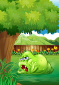 A tired green monster near the tree — Stock Vector