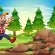 A cheerful lumberjack near the rocks — Stock Vector