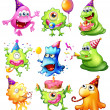 Happy monsters celebrating a birthday — Stock Vector