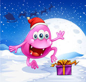 A happy pink beanie monster wearing Santa's hat — Vector de stock