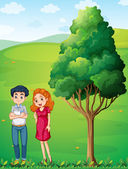 A mother and a father near the big tree at the hilltop — Stock Vector