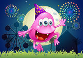 A happy pink beanie monster at the carnival — Stock Vector
