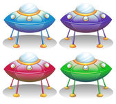 Colorful UFO saucers — Stock Vector