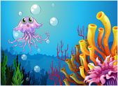 An octopus and the coral reefs under the sea — Stock Vector