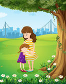 A mother and her daughter under the tree — Stock Vector