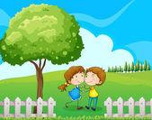 A couple near the tree — Stock Vector