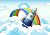 A rocket near the rainbow — Stock Vector