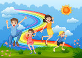 A family at the hilltop playing with the rainbow — Stock Vector