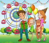 A happy family at the carnival — Stock vektor