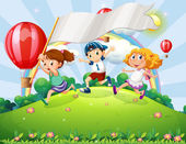 Kids with an empty banner running at the hilltop with a rainbow — Stock Vector