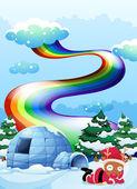 A rainbow above the igloo beside the reindeer — Stock Vector