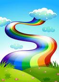 A rainbow in the clear blue sky — Stock Vector