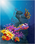 An eel under the sea with coral reefs — Stock Vector