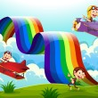 A red and a violet plane with monkeys flying near the rainbow — Stock Vector