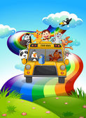 A zoo bus travelling through the rainbow road — Stock Vector