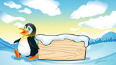 A penguin and an empty wooden template in the snowy area — Stock Vector