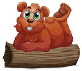 A bear resting above the log — Stock Vector
