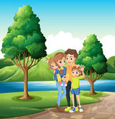 A family at the riverbank — Stock Vector
