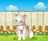 A sad cat near the wooden fence — Stock Vector