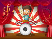 A boy at the center of the stage with a drum — Stock Vector
