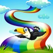 A bird flying near the rainbow — Stock Vector