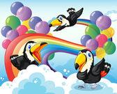 Üç kuş gökkuşağı ve balonlar — Stok Vektör
