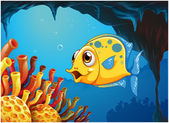 A big yellow fish under the sea inside the sea cave — Stock Vector