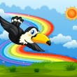 A bird in the sky with a rainbow — Stock Vector #39488133