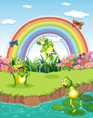 Three playful frogs at the pond and a rainbow in the sky — Stock Vector